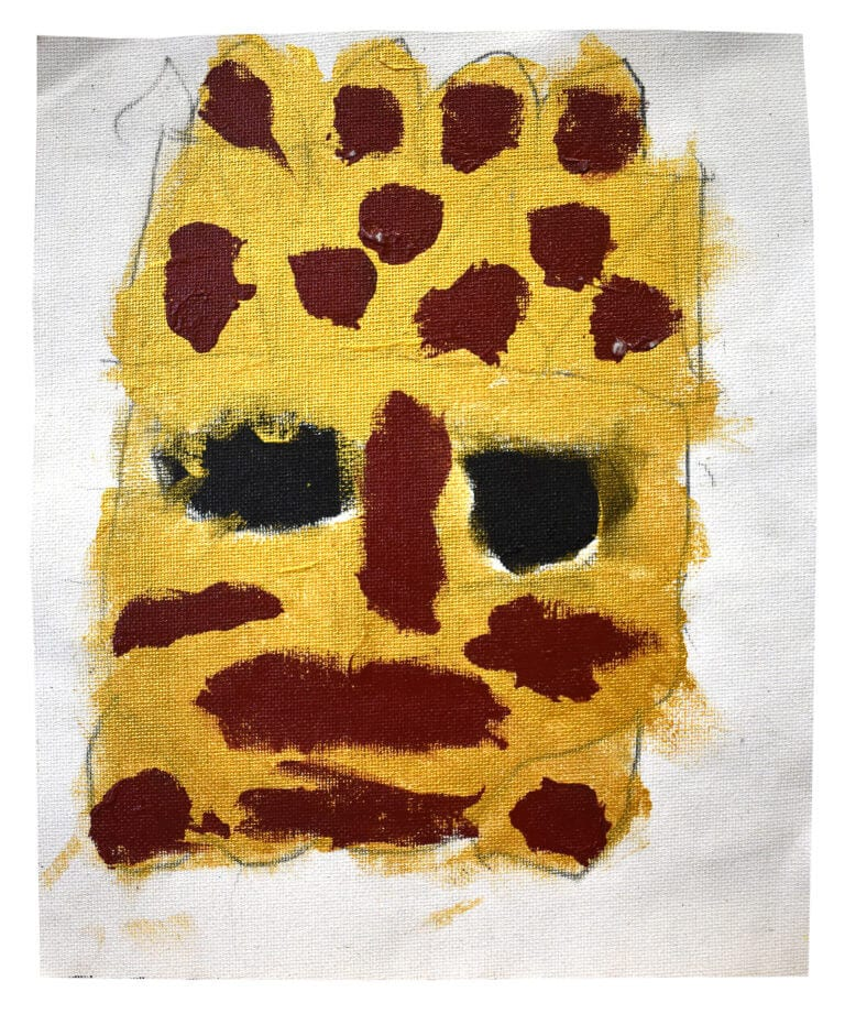 Yellow face with red marks and black eyes