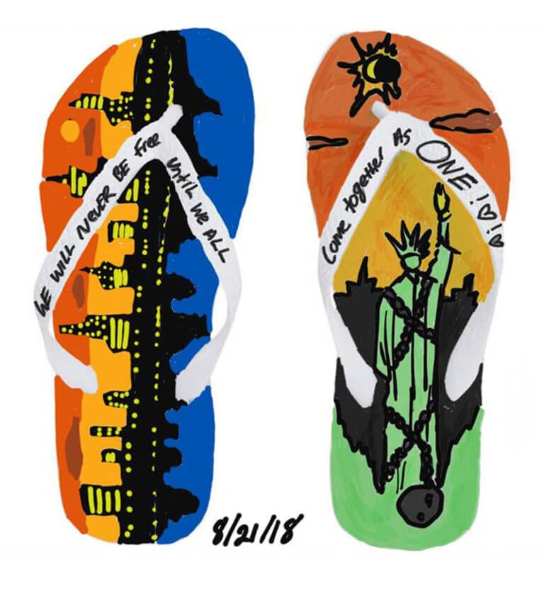 A digtally rendered design of sandals with New York City iconography