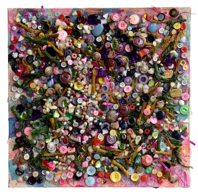 A square-shaped collage made with paper, buttons, twine, and small trinkets
