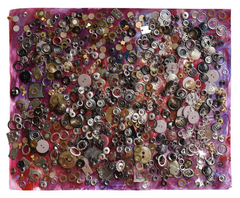 An assortment of small metal trinkets arranged in a collage on a mostly magenta background