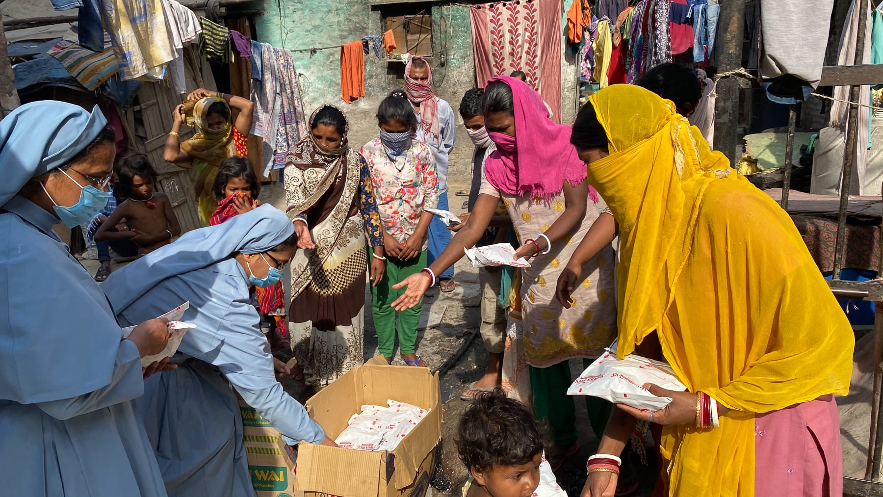 two nuns in india distribute supplies provided by CNEWA.