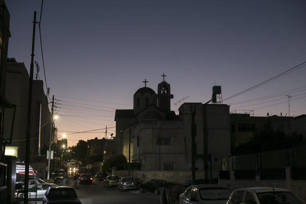 a street of the al hashemi al shamali district of amman is seen in the fading evening light.