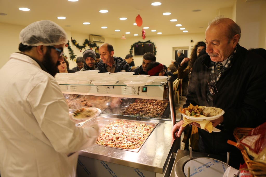 man being served a plate at a food pantry.