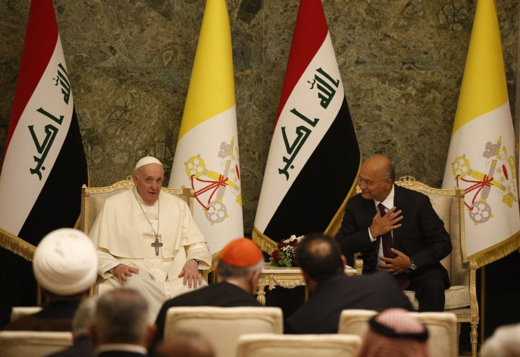 Pope Francis and Iraqi President Barham Salih attend a meeting in the hall of the presidential palace in Baghdad
