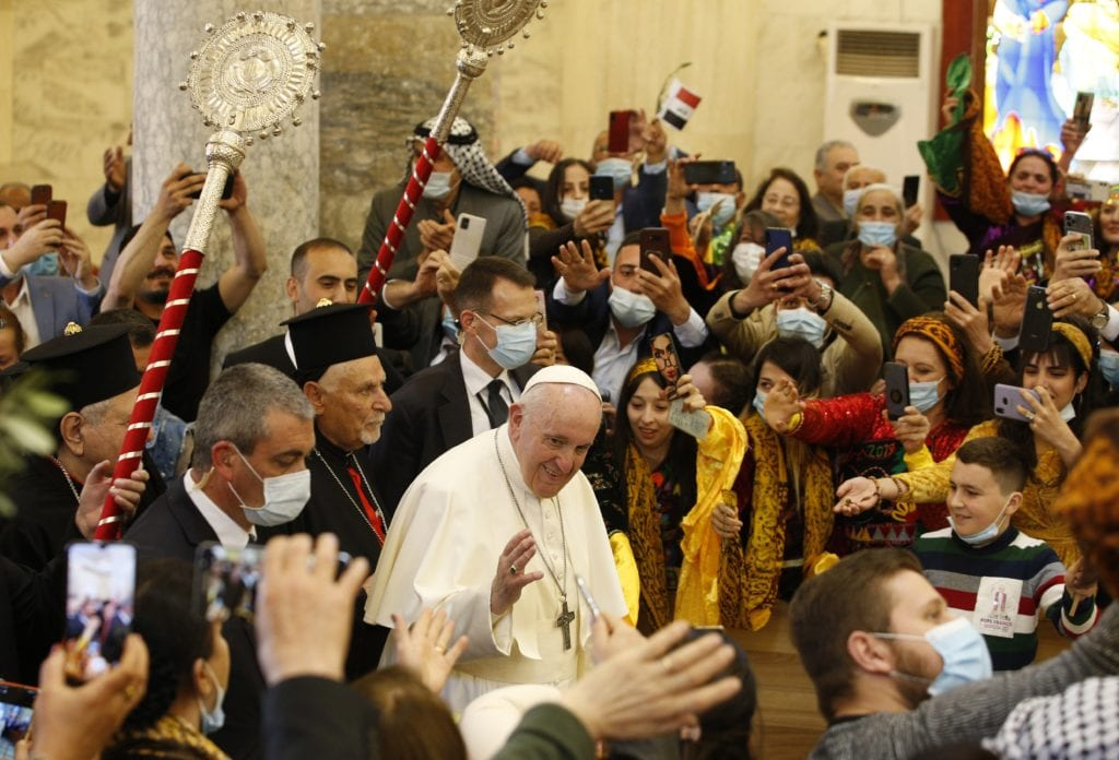 Pope Francis is greeted by a crowd of enthusiastic faithful at the Church of the Immaculate Conception in Qaraqosh, Iraq