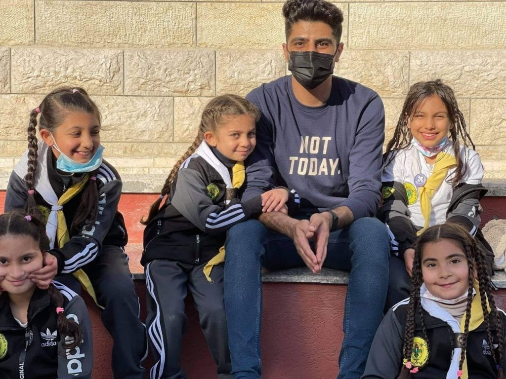 Hussam Saba, a recipient of the CNEWA-Pontifical Mission Christian Student Scholarship, volunteers with the St. Joseph Scouts in Gaza.