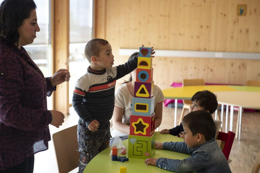 young Armenian children play with blocks.