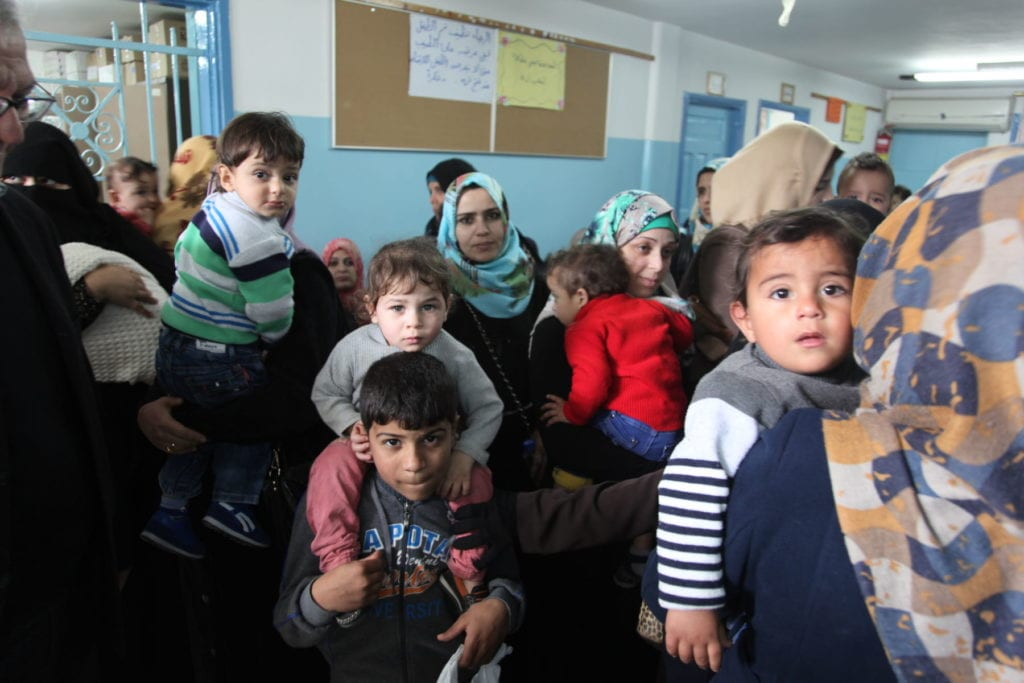 people gather in a clinic for health care in Gaza City in the Palestinian territories.