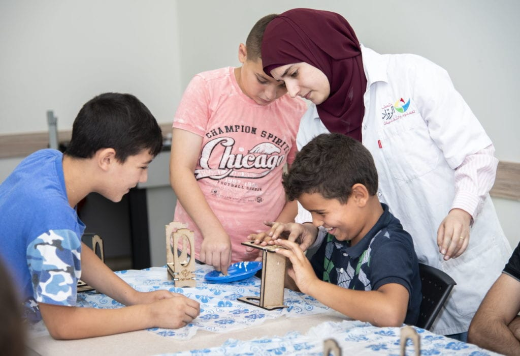 children work on crafts in the House of Grace in Israel.