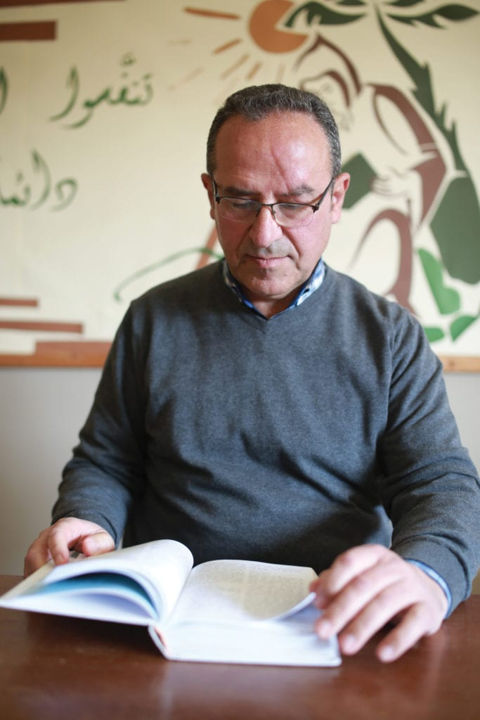 a photo of Pierre Habib reading a book.